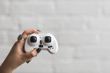 hand holding drone controller