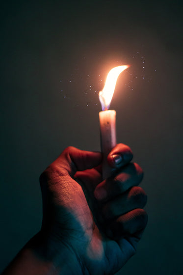 hand holds a lite candle