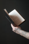 hand holds out an open book