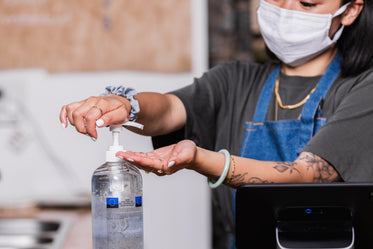 hand sanitizing while wearing a face mask