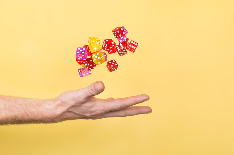 hand-throwing-dice-on-yellow.jpg?width=7