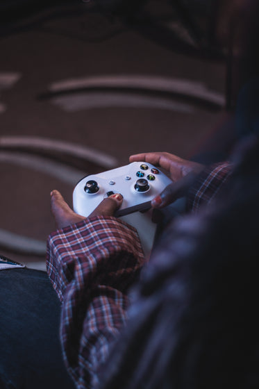 hands hold a video game controller
