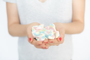 Picture of Hands Holding Marshmallow Candy - Free Stock Photo