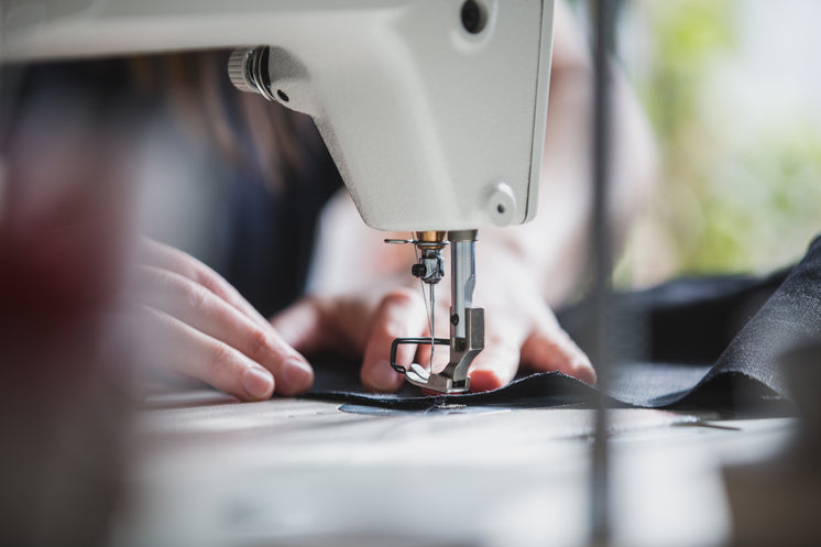 Hands Sewing Fabric
