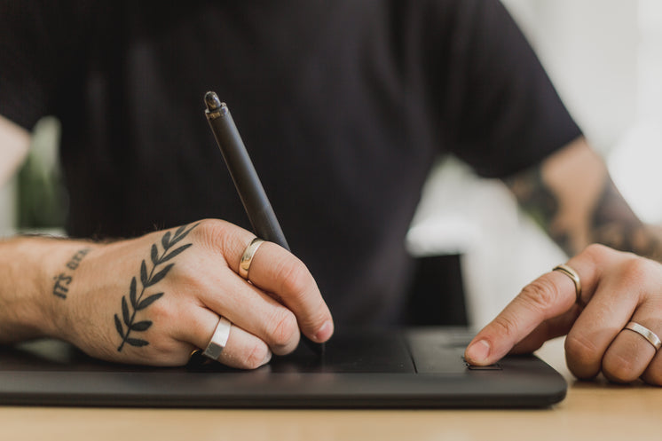 Hands Using Tablet For Design Editing