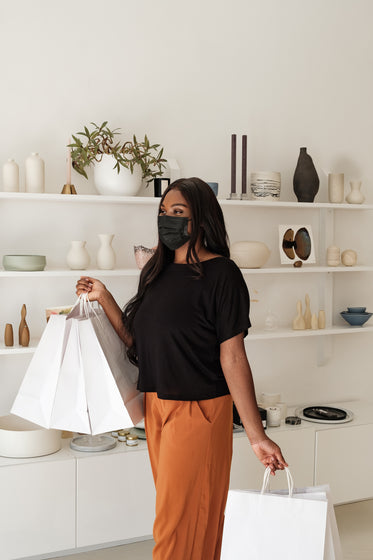 happy woman and shopping bags in store