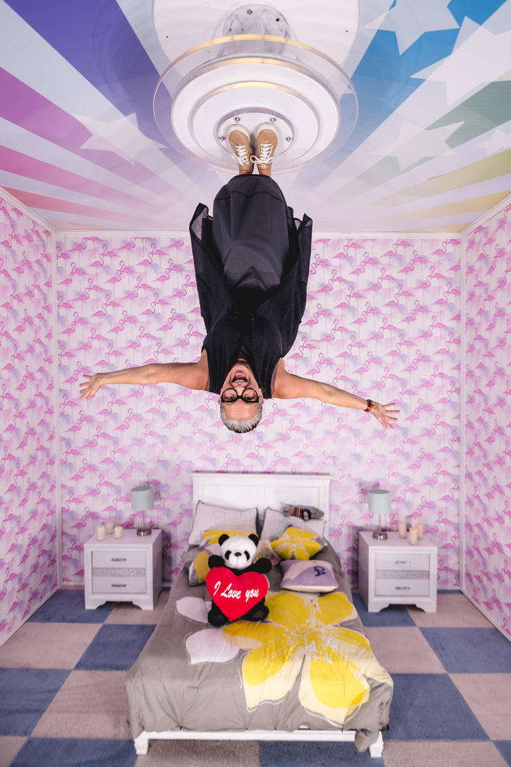 Happy woman In upside Down Playroom
