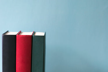 hard cover books on blue background