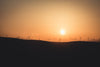 hazy sunset silhouettes landscape with windmills