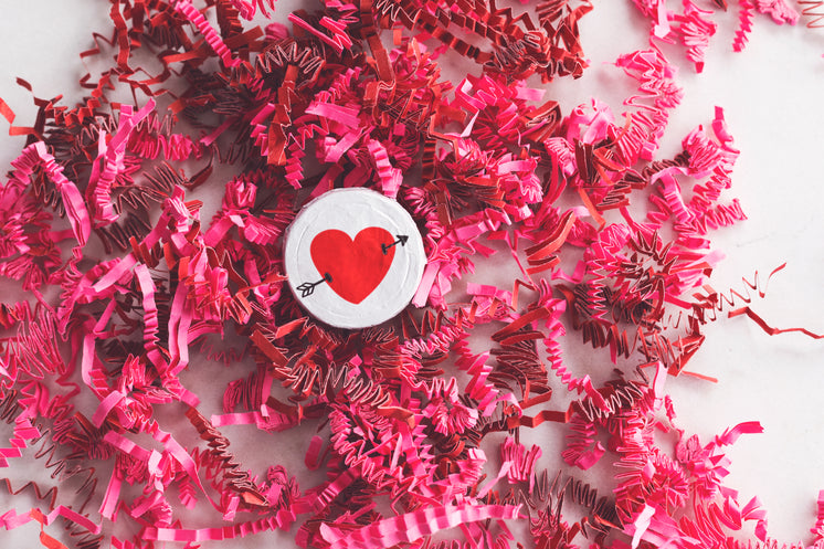 Heart Candy On Top Of Pink Decorations