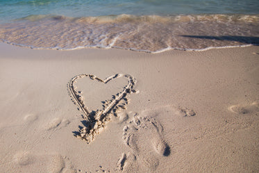 heart in vacation sand