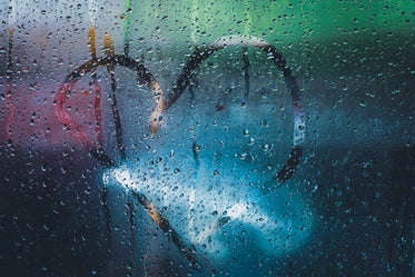 heart shape traced on condensation covered window