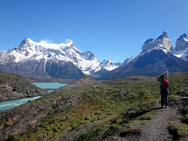 hiker near snow capped mountain