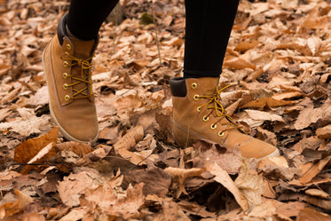 hiker steping on leaves as they walk through