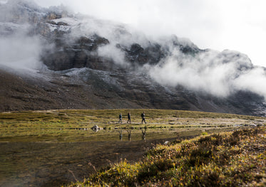 hikers below the misty mountains