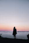 hiking above clouds at sunset