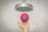 holding shower speaker