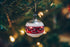 holiday decorated ball ornament on tree