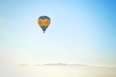 hot air balloon rising into the atmosphere