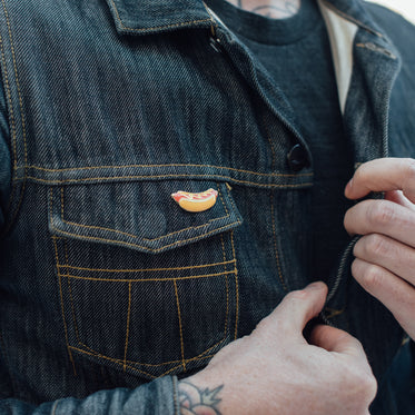 man unbuttoning jean jacket