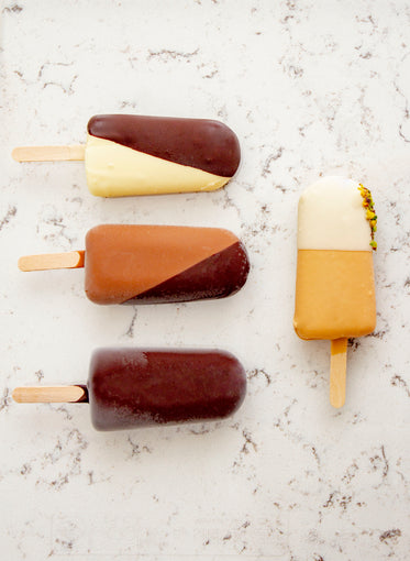 ice-creams of different shades on a marble counter