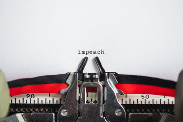 impeach message on typewriter