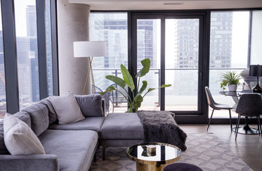 interior design of a grey and gold living room