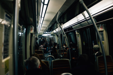 interior of a dark transit vehicle with people nearby