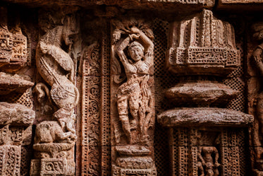 intricate stone sculpture with pillars