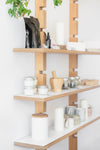 jars, candles and ceramics on wooden shelves