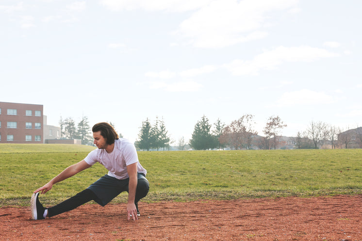 jogger-stretching-at-track.jpg?width=746