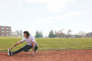 jogger stretching at track
