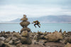 jumping action shot on rocky beach