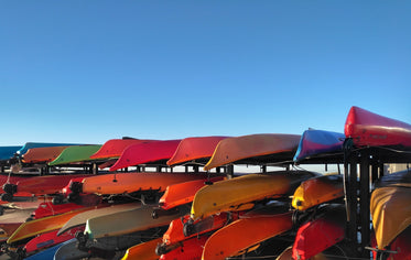 kayaks on racks under blue sky.jpeg