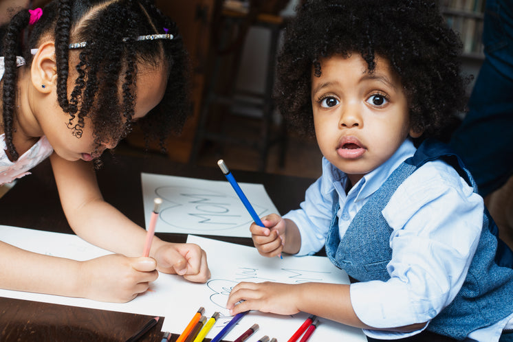Kids Coloring At Table
