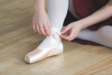 lacing up ballet slippers