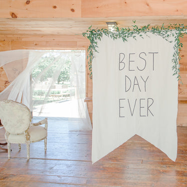 large sign saying best day ever at wedding