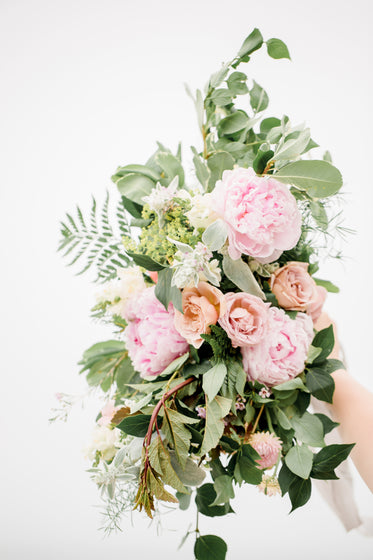 large wedding bouquet held up