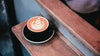 latte art in cup at cafe