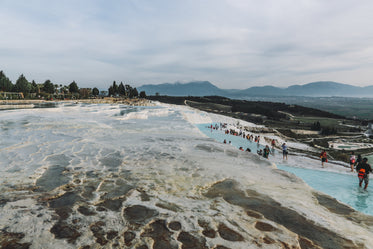 layered thermal pools with tourists