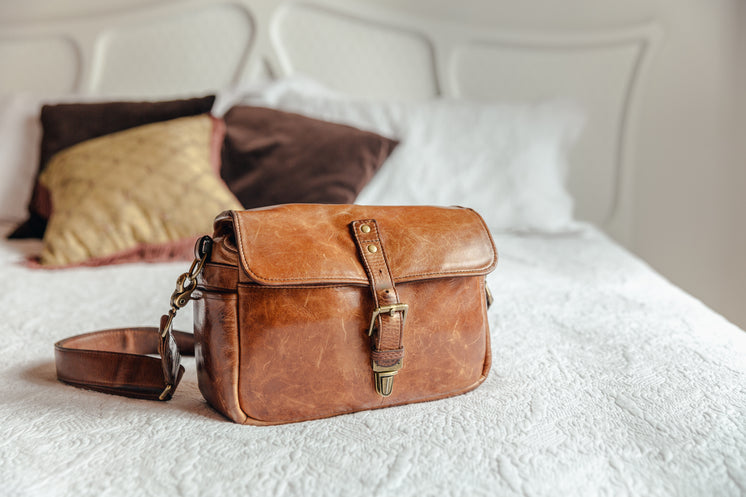 Leather Handbag On Bed