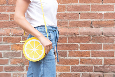lemon purse being worn