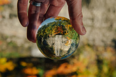 lens ball with fall trees and waterfall