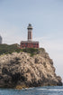 light house on rocky cliff in capri italy