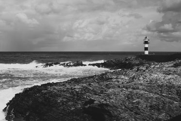 lighthouse and crashing waves
