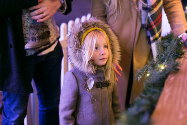 little girl at holiday market