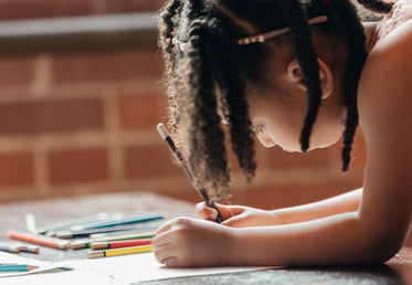 little girl drawing is focused