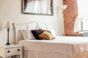 loftstyle bedroom with throw pillows
