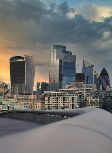 london cityscape at cloudy  sunset with glass buildings