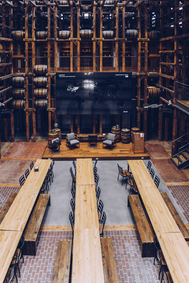 long wooden tables in hall from above